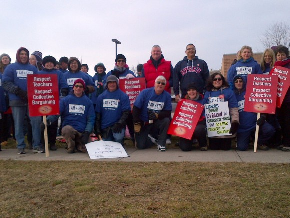 EBM's Pete Wright and Gord Longhi attended the ETFO picket line at James Strath Public School in Peterborough Dec 14th to support ETFO teachers in their battle against Bill 115.