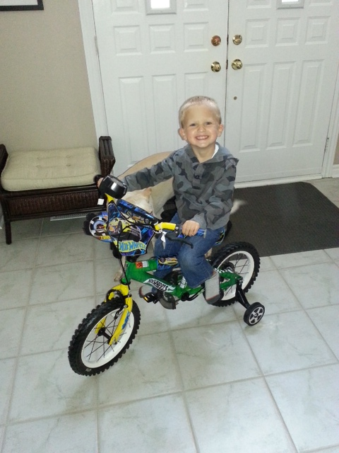 "Logan says a big ""Thank You""    He loves his new bike."